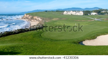 Golf course by the ocean - stock photo