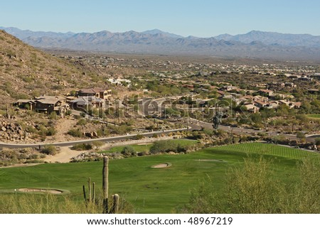 golf course, houses, and mountains in arizona - stock photo