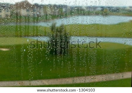 Golf course in the rain. This image has more rain drops but more clear background view. Can also be a nice background image. This is a photo from A Raining Day Collection. Search keyword Series005 - stock photo