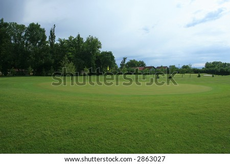 Golf course landscape in springtime - stock photo