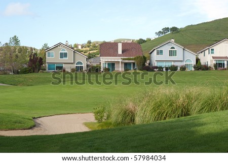 golf course views with sand trap - stock photo