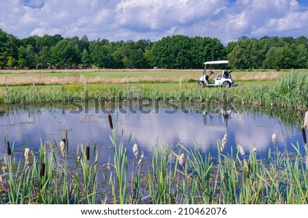 Golf course water pond reflection - stock photo