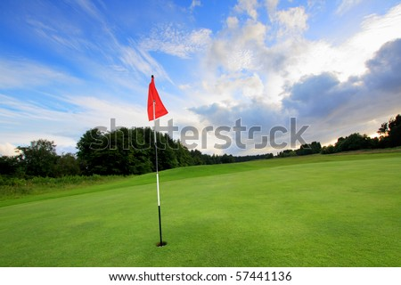Golf course with amazing clouds in Scotland - stock photo