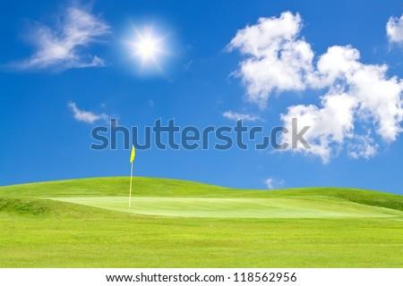 golf course with beautiful sky adn sun - stock photo