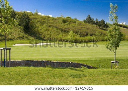 Golf course with golf hole and flag