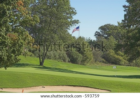Golf course with US flag in background