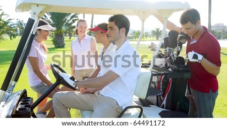 Golf course young team people group buggy green grass field - stock photo