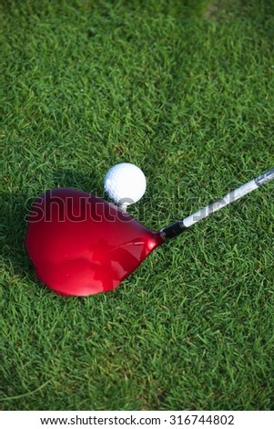 Golf Driver Hitting Golf Ball on Golf Tee - stock photo