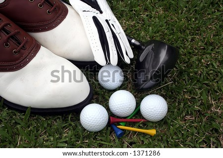 Golf equipment and accessories over grass