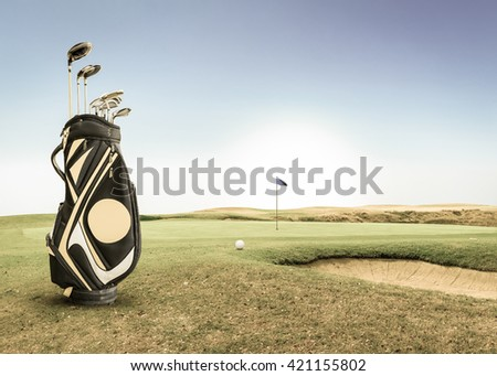 golf equipment on green and hole as background.vintage tone