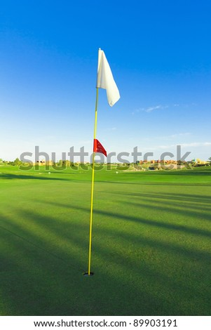 Golf Flag Spread On The Wind - stock photo