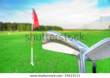 Golf game. Golf clubs against the golf course. - stock photo