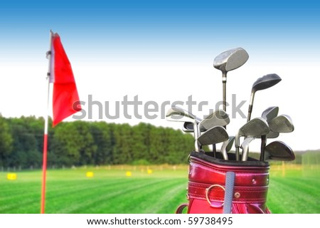 Golf game. Golf clubs in bag against the golf course. - stock photo