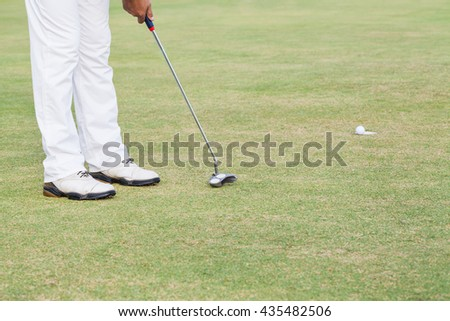 Golf hole on grass - stock photo