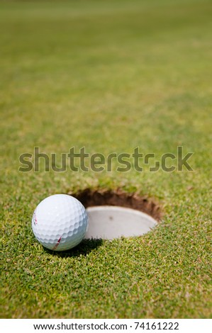 golf hole with ball - stock photo