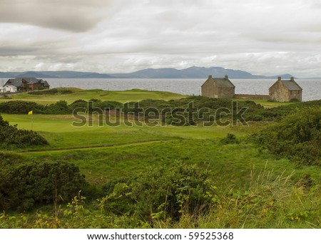 Golf in Scotland, Prestwick St. Nicholas signature holes 2 and 3. Backdrop Isle of Arran. - stock photo