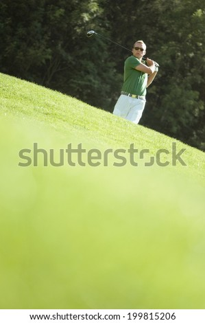 Golf player on the course - stock photo