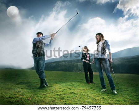golf player teeing off golf ball from tee box, wonderful cloud formation in background - stock photo