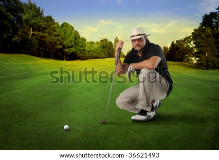 golf player with putter thinking of good shot - stock photo