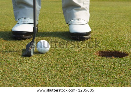 golf putting - stock photo