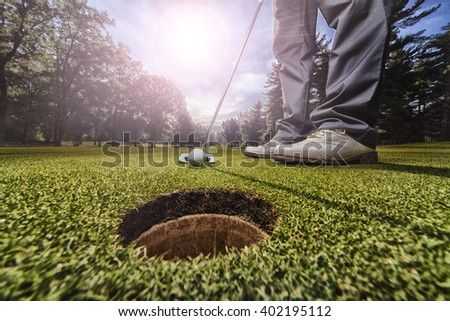 Golf putting in green - stock photo