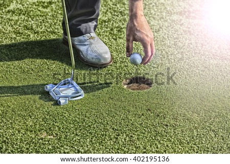 Golf putting in green