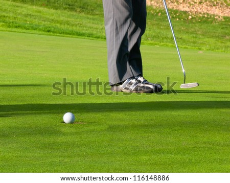 Golf putting in the hole on green - stock photo