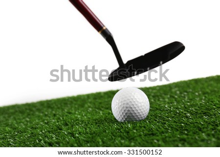 Golf set on grass isolated on white - stock photo