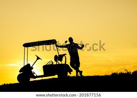 Golf Sunset Silhouette - stock photo
