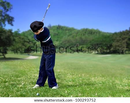 Golf swing junior - stock photo