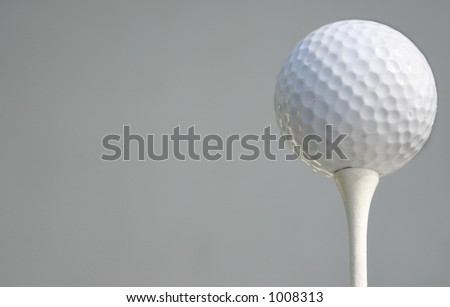 Golfball with light grey br - stock photo