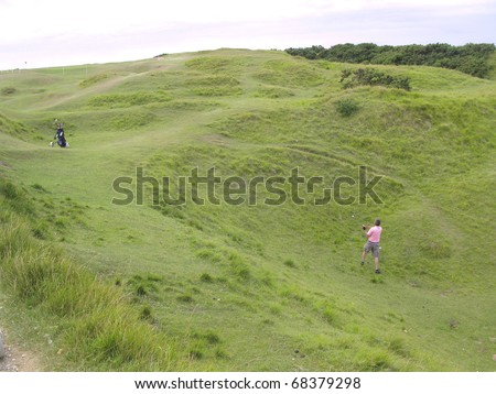 Golfer at a difficult position - stock photo