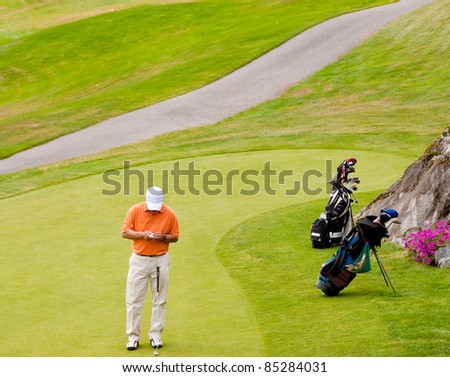 Golfer at green area. - stock photo