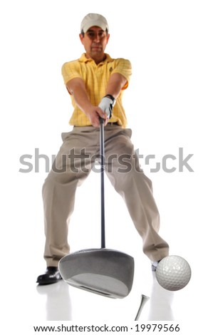 Golfer at the moment of impact with selective depth of field - stock photo