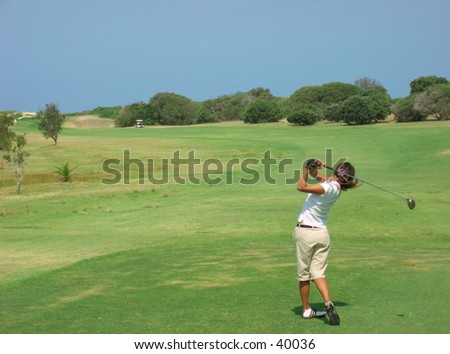 Golfer follow through.