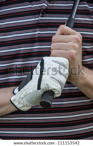 Golfer Hand with Glove Holding Club Close up - stock photo