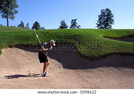 Golfer hitting out of a sand trap (1 of 3 shot action sequence) - stock photo