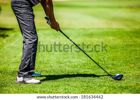 Golfer on a Golf Course on the Start with lot of Copyspace for your text (preparation) - stock photo