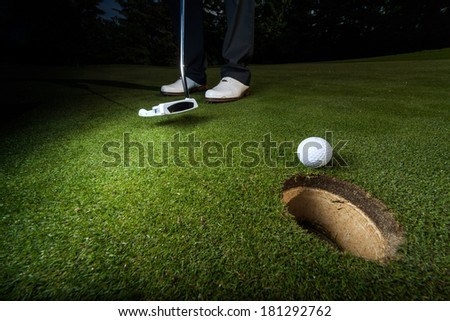 golfer putting in greens - stock photo