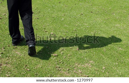 Golfer's shadow after completion of swing