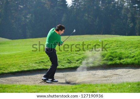 Golfer Sand trap, Golfer chipping the ball from sand trap - stock photo