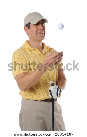 Golfer tossing a ball isolated on a white background - stock photo