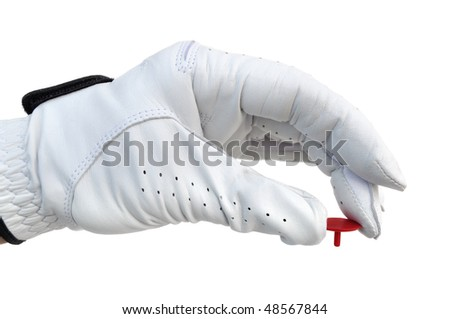Golfer Wearing Golf Glove Holding a Red Ball Marker - stock photo
