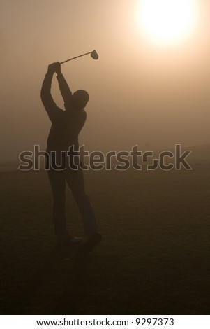 Golfers and golf course action in the morning - stock photo