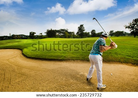 Golfers are hit Ball on the sand courts - stock photo
