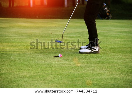 Golfers are putting golf in the evening golf course golf backglound in Thailand