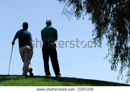 Golfers Stand At Top of Elevated Green at Tijeras Creek - stock photo
