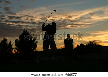 Golfing at Sunset - stock photo