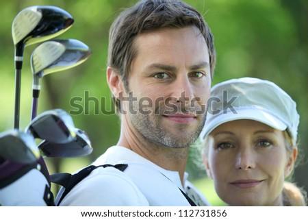 Golfing couple - stock photo