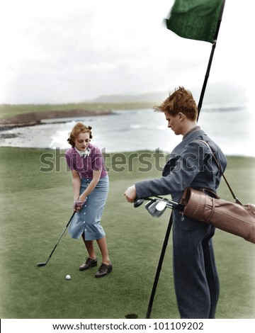 Golfing on the coast - stock photo